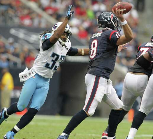 Houston Texans quarterback Matt Schaub (8) evades the sack attempt by Tennessee Titans free safety Michael Griffin (33) during the second quarter at Reliant Stadium on Sunday, Sept. 30, 2012, in Houston. Photo: Karen Warren, Houston Chronicle / © 2012  Houston Chronicle