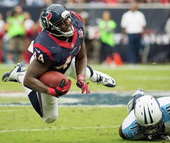 Houston Texans running back Ben Tate (44) is knocked off his feat by Tennessee Titans defensive end Pannel Egboh (79) during the third quarter at Reliant Stadium on Sunday, Sept. 30, 2012, in Houston.  The Texans won the game 38-14. Photo: Smiley N. Pool, Houston Chronicle / © 2012  Houston Chronicle