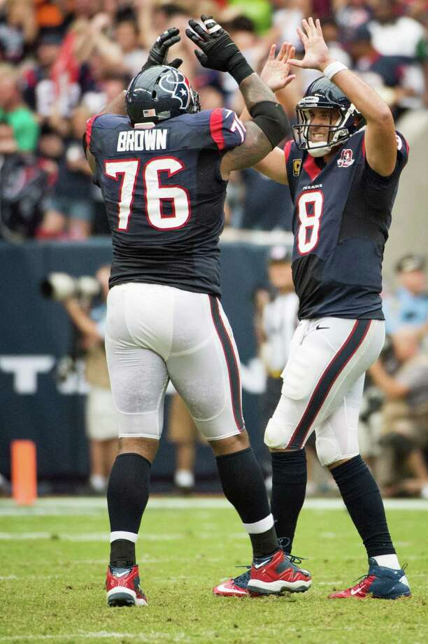 Houston Texans quarterback Matt Schaub (8) celebrates with tackle Duane Brown (76) after throwing a 28-yard touchdown pass to  Owen Daniels during the third quarter against the Tennessee Titans at Reliant Stadium on Sunday, Sept. 30, 2012, in Houston.  The Texans won the game 38-14. Photo: Smiley N. Pool, Houston Chronicle / © 2012  Houston Chronicle