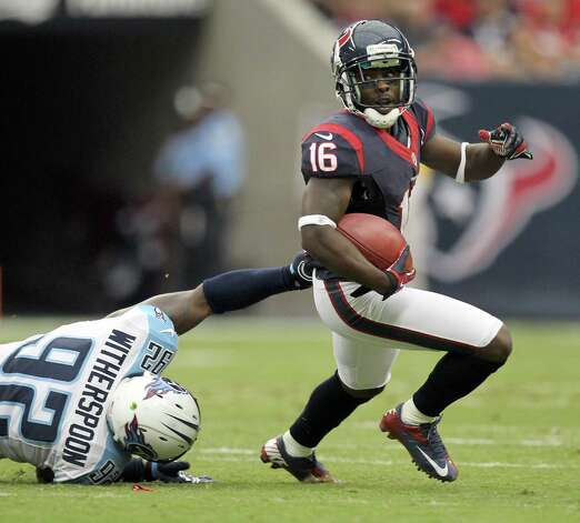 Houston Texans wide receiver Trindon Holliday (16) gets away from Tennessee Titans middle linebacker Will Witherspoon (92) on a kick return during the first quarter at Reliant Stadium on Sunday, Sept. 30, 2012, in Houston. Photo: Nick De La Torre, Houston Chronicle / © 2012  Houston Chronicle