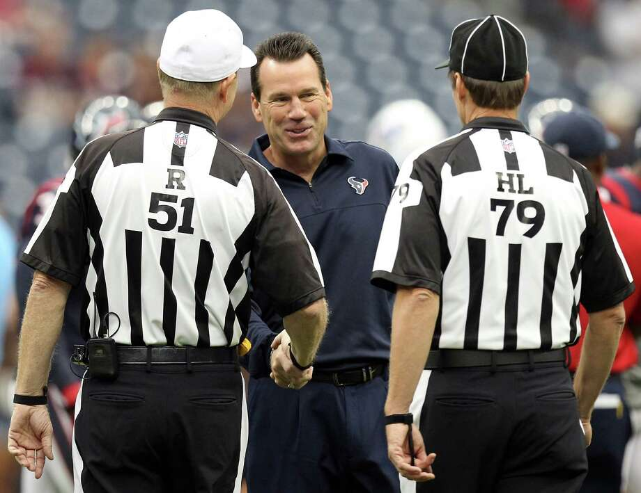 Houston Texans head coach Gary Kubiak greets football referees Carl Cheffers (51) and Kent Payne (79)before his game against the Tennessee Titans at Reliant Stadium on Sunday, Sept. 30, 2012, in Houston. The Houston Texans won 38-14. Photo: Nick De La Torre, Houston Chronicle / © 2012  Houston Chronicle