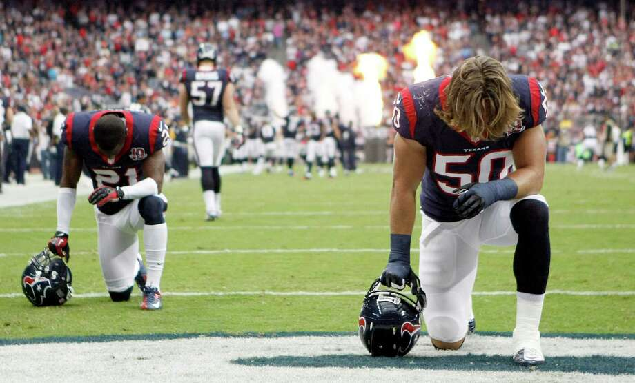 Houston Texans linebacker Bryan Braman (50), front, and Houston Texans defensive back Brice McCain (21) have a moment of silence before their game against the Tennessee Titans at Reliant Stadium on Sunday, Sept. 30, 2012, in Houston. The Houston Texans won 38-14. Photo: Nick De La Torre, Houston Chronicle / © 2012  Houston Chronicle