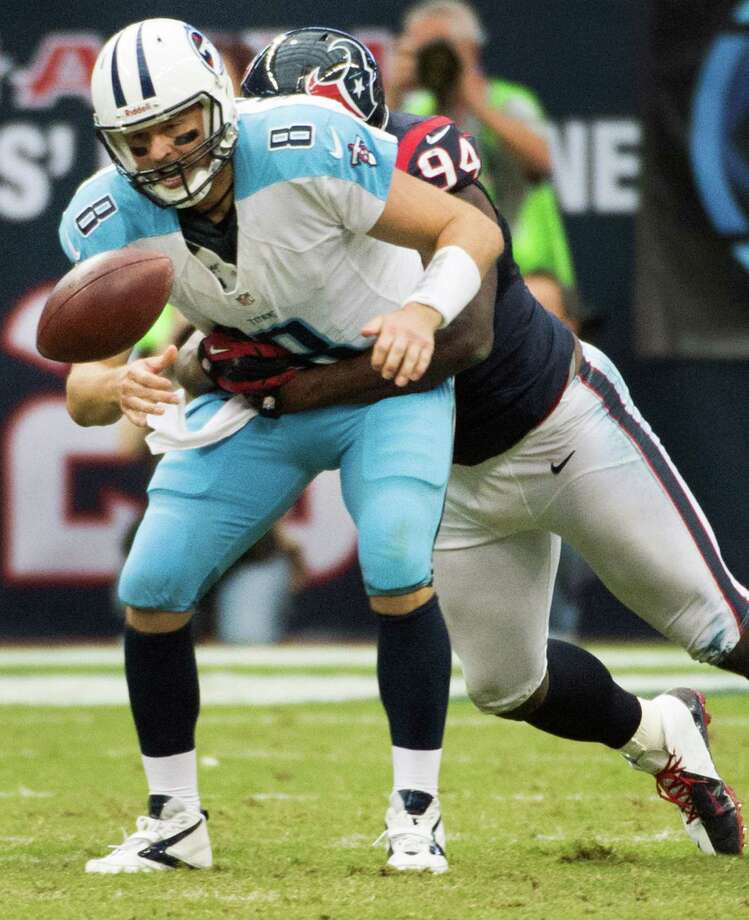 Tennessee Titans quarterback Matt Hasselbeck (8) fumbles as he is hit by Houston Texans defensive end Antonio Smith (94) during the fourth quarter at Reliant Stadium on Sunday, Sept. 30, 2012, in Houston.  The Texans won the game 38-14. Photo: Smiley N. Pool, Houston Chronicle / © 2012  Houston Chronicle