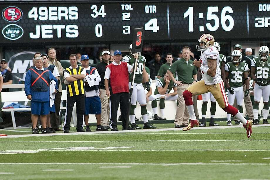 On Sunday, September 30, 2012, San Francisco 49er, Colin Kaepernick, runs for a long gain before sliding near the Jets endzone. On Sunday, the San Francisco 49ers beat the New York Jets, 34-0, at Metlife Stadium in Rutherford, New Jersey.  2012_09.30_49ERSVJETS  CREDIT: Bryan Thomas for The San Francisco Chronicle Photo: Bryan Thomas