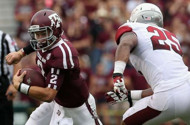 "3. Texas A&M (3-1, next week @ Mississippi) — ""Johnny Football"" seems to play better every week. The A&M defense is following his lead. (Ronald Martinez / Getty Images)"