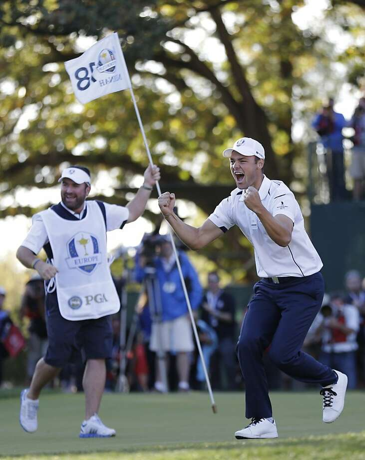 Martin Kaymer exults after his 6-foot par putt beat Steve Stricker and gave Europe, which had trailed 10-6, the point it needed to keep the Ryder Cup. Photo: David J. Phillip, Associated Press