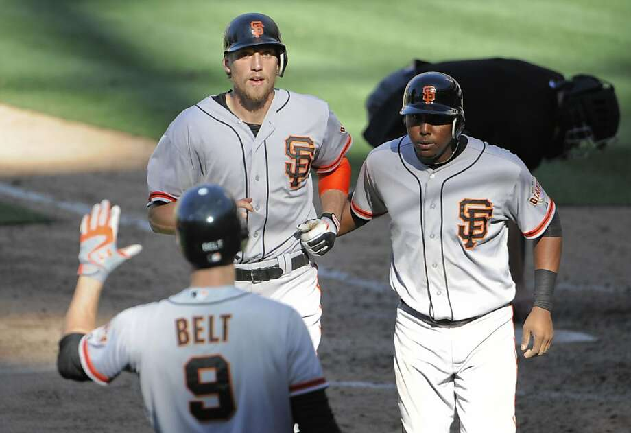 SAN DIEGO, CA - SEPTEMBER 30: Hunter Pence #8 of the San Francisco Giants, left, is congratulated by Francisco Peguero #14, right, and Brandon Belt #9 after he hit a two-run homer during the ninth inning of a baseball game against the San Diego Padres at Petco Park on September 30, 2012 in San Diego, California. The Giants won 7-5.   (Photo by Denis Poroy/Getty Images) Photo: Denis Poroy, Getty Images