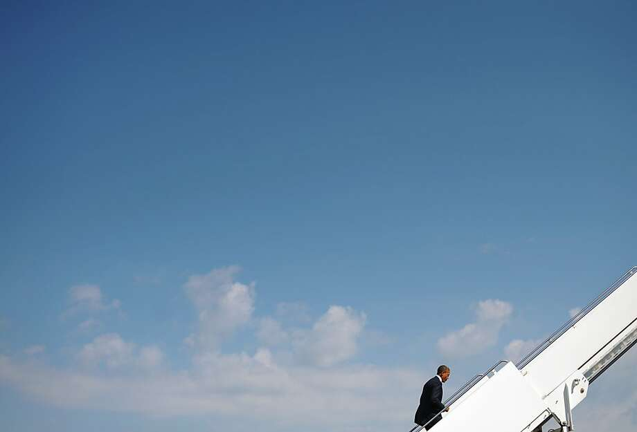 US President Barack Obama boards Air Force One on September 30, 2012 before departing from Andrews Air Force Base in Maryland. Obama is traveling to Nevada for a campaign rally and to prepare for the first presidential debate with Republican Presidential nominee Mitt Romney on October 3 in Denver, Colorado.  TOPSHOTS/AFP PHOTO/Mandel NGANMANDEL NGAN/AFP/GettyImages Photo: Mandel Ngan, AFP/Getty Images