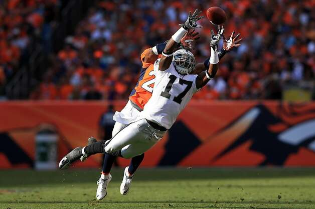 DENVER, CO - SEPTEMBER 30:  Wide receiver Denarius Moore #17 of the Oakland Raiders is unable to make a reception as cornerback Champ Bailey #24 of the Denver Broncos defends at Sports Authority Field at Mile High on September 30, 2012 in Denver, Colorado.  (Photo by Doug Pensinger/Getty Images) Photo: Doug Pensinger, Getty Images
