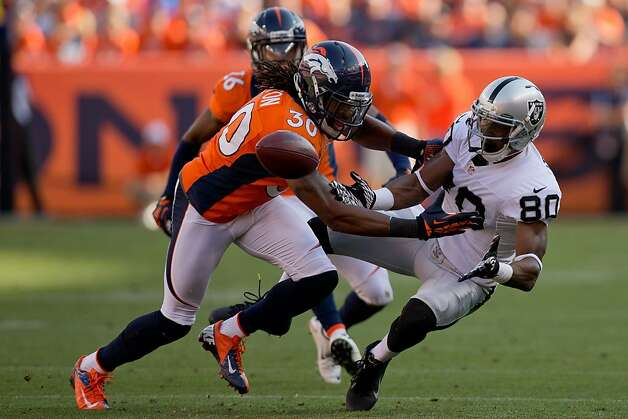 DENVER, CO - SEPTEMBER 30:  Safety David Bruton #30 of the Denver Broncos breaks up a pass intended for wide receiver Rod Streater #80 of the Oakland Raiders during the third quarter at Sports Authority Field Field at Mile High on September 30, 2012 in Denver, Colorado. (Photo by Justin Edmonds/Getty Images) Photo: Justin Edmonds, Getty Images