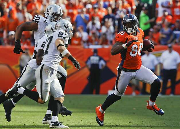 Denver Broncos wide receiver Demaryius Thomas (88) runs the ball against Oakland Raiders free safety Matt Giordano (27), Oakland Raiders cornerback Pat Lee (26) and Oakland Raiders defensive tackle Richard Seymour (92) during the fourth quarter of an NFL football game, Sunday, Sept. 30, 2012, in Denver. (AP Photo/David Zalubowski) Photo: David Zalubowski, Associated Press