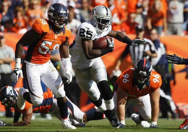 Oakland Raiders running back Mike Goodson (25) runs the ball against Denver Broncos outside linebacker Von Miller (58) and defensive end Mitch Unrein (96) during the third quarter of an NFL football game, Sunday, Sept. 30, 2012, in Denver. (AP Photo/David Zalubowski) Photo: David Zalubowski, Associated Press