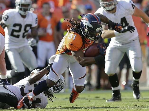 Denver Broncos cornerback Omar Bolden (31) is tackled by Oakland Raiders defensive back Coye Francies (31) during the third quarter of an NFL football game, Sunday, Sept. 30, 2012, in Denver. (AP Photo/Joe Mahoney) Photo: Joe Mahoney, Associated Press