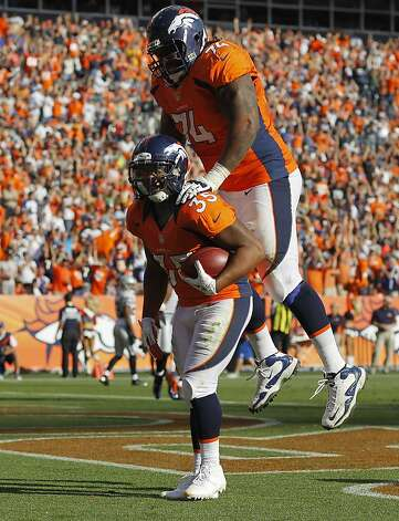 Denver Broncos running back Lance Ball (35) celebrates with Denver Broncos tackle Orlando Franklin (74) after scoring a touchdown against the Oakland Raiders during the third quarter of an NFL football game, Sunday, Sept. 30, 2012, in Denver. (AP Photo/David Zalubowski) Photo: David Zalubowski, Associated Press