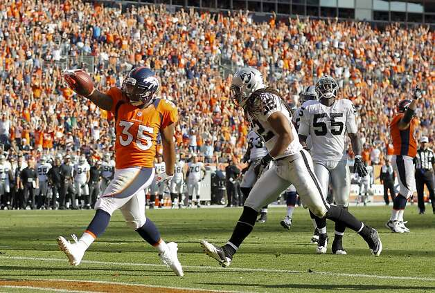 Denver Broncos running back Lance Ball (35) reacts after crossing the goal line against Oakland Raiders outside linebacker Philip Wheeler (52) for a touchdown during the third quarter of an NFL football game, Sunday, Sept. 30, 2012, in Denver. (AP Photo/David Zalubowski) Photo: David Zalubowski, Associated Press