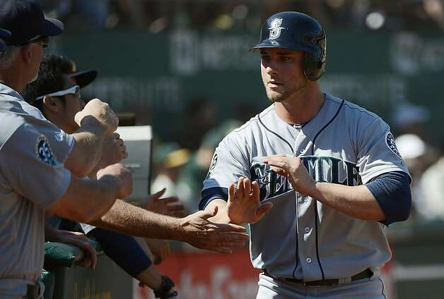 OAKLAND, CA - SEPTEMBER 30:  Casper Wells #33 of the Seattle Mariners is congratulated by teammates after Wells scored on an RBI single from Justin Smoak #17 (not pictured) in the third inning against the Oakland Athletics at O.co Coliseum on September 30, 2012 in Oakland, California.  (Photo by Thearon W. Henderson/Getty Images) Photo: Thearon W. Henderson, Getty Images