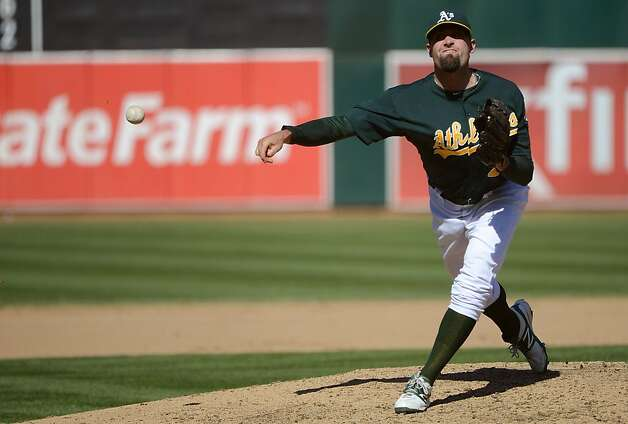 OAKLAND, CA - SEPTEMBER 30:  Pat Neshek #40 of the Oakland Athletics pitches in the six inning against the Seattle Mariners at O.co Coliseum on September 30, 2012 in Oakland, California.  (Photo by Thearon W. Henderson/Getty Images) Photo: Thearon W. Henderson, Getty Images