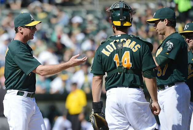 OAKLAND, CA - SEPTEMBER 30:  Manager Bob Melvin #6 of the Oakland Athletics takes the ball from pitcher Tommy Milone #57 taking him out of the game as catcher George Kottaras #14 looks on in the six inning against the Seattle Mariners at O.co Coliseum on September 30, 2012 in Oakland, California.  (Photo by Thearon W. Henderson/Getty Images) Photo: Thearon W. Henderson, Getty Images