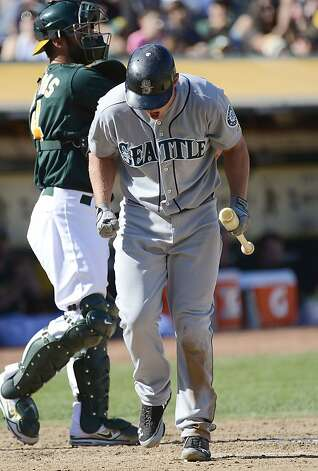 OAKLAND, CA - SEPTEMBER 30:  Kyle Seager #15 of the Seattle Mariners reacts to striking out in the seventh inning against the Oakland Athletics at O.co Coliseum on September 30, 2012 in Oakland, California.  (Photo by Thearon W. Henderson/Getty Images) Photo: Thearon W. Henderson, Getty Images