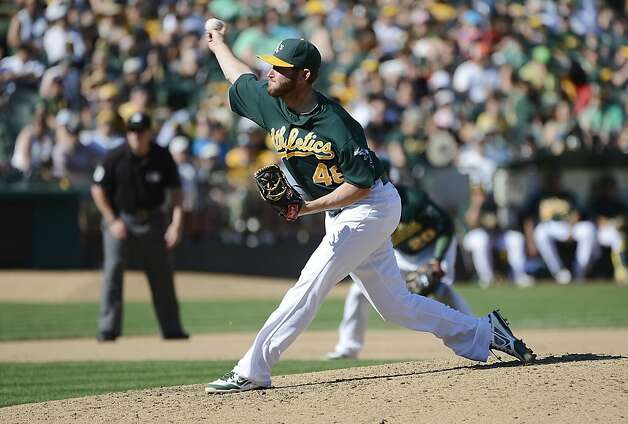 OAKLAND, CA - SEPTEMBER 30:  Ryan Cook #48 of the Oakland Athletics pitches in the seventh inning against the Seattle Mariners at O.co Coliseum on September 30, 2012 in Oakland, California.  (Photo by Thearon W. Henderson/Getty Images) Photo: Thearon W. Henderson, Getty Images