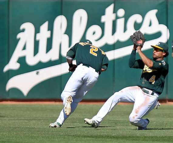 Oakland Athletics Coco Crisp catches Seattle Mariners Ryan Brendan fly ball to center field in the fourth inning of their MLB baseball game Sunday September 30, 2012 in Oakland California Photo: Lance Iversen, The Chronicle
