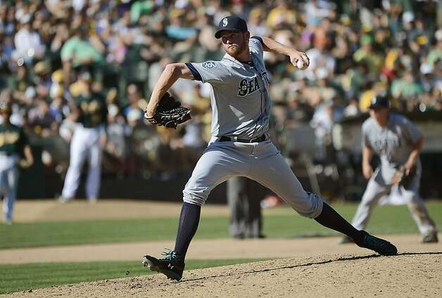 OAKLAND, CA - SEPTEMBER 30:  Charlie Furbush #41 of the Seattle Mariners pitches in the seventh inning against the Oakland Athletics at O.co Coliseum on September 30, 2012 in Oakland, California.  (Photo by Thearon W. Henderson/Getty Images) Photo: Thearon W. Henderson, Getty Images