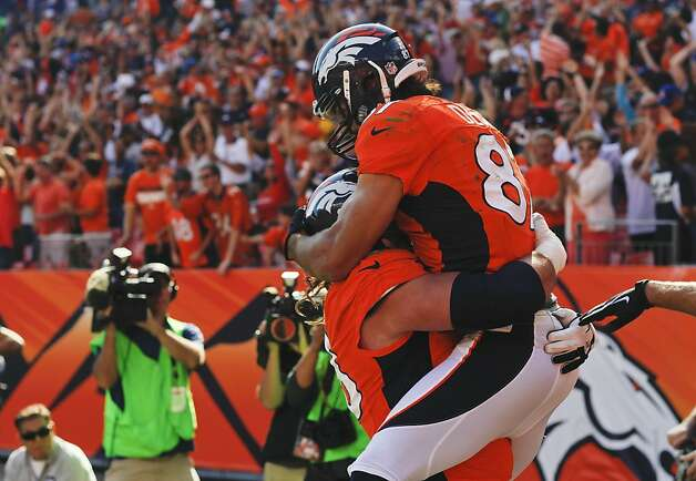 Denver Broncos wide receiver Eric Decker (87) celebrates with guard Zane Beadles (68) after scoring a touchdown against the Oakland Raiders during the third quarter of an NFL football game, Sunday, Sept. 30, 2012, in Denver. (AP Photo/David Zalubowski) Photo: David Zalubowski, Associated Press