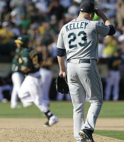 Seattle Mariners' Shawn Kelley (23) turns his back as Oakland Athletics' Yoenis Cespedes runs the bases after hitting a home run off Kelley in the eighth inning of a baseball game Sunday, Sept. 30, 2012, in Oakland, Calif. (AP Photo/Ben Margot) Photo: Ben Margot, Associated Press