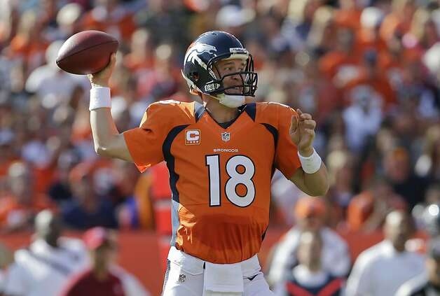 Denver Broncos quarterback Peyton Manning (18) throws against the Oakland Raiders during the second quarter of an NFL football game, Sunday, Sept. 30, 2012, in Denver. (AP Photo/Joe Mahoney) Photo: Joe Mahoney, Associated Press