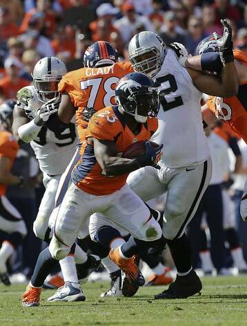 Denver Broncos running back Willis McGahee (23) runs the ball against the Oakland Raiders during the second quarter of an NFL football game, Sunday, Sept. 30, 2012, in Denver. (AP Photo/Joe Mahoney) Photo: Joe Mahoney, Associated Press