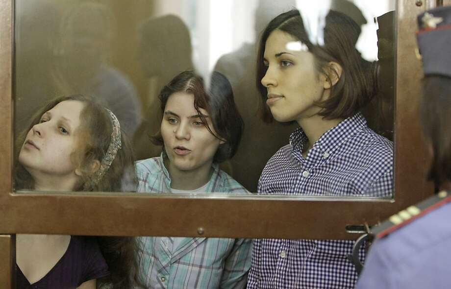 Yekaterina Samutsevich (left), Maria Alekhina and Nadezhda Tolokonnikova, members of feminist punk group Pussy Riot, face two-year sentences. Photo: Mikhail Metzel, Associated Press