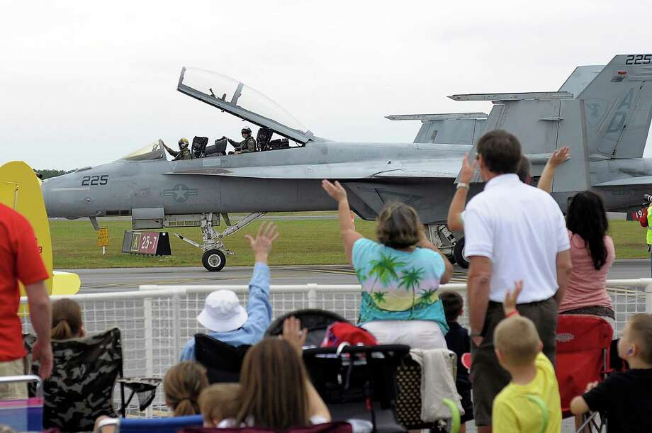 The crowd waves to the pilots of an F/A-18 Super Hornet as it taxi's off the runway Sunday, Sept. 30, 2012 during the Wings Over North Georgia Air Show at Richard B. Russell Airport in Rome, Ga. (AP Photo/Rome News-Tribine, Daniel Varnado) Photo: Daniel Varando, Associated Press / The Rome News-Tribune