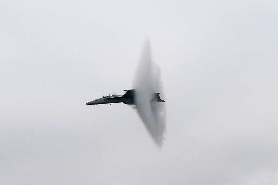 An F/A-18 Super Hornet reaches supersonic speeds Saturday, Sept. 30, 2012 during the Wings Over Nort