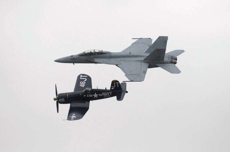 An F/A-18F Super Hornet escorts an F4U Corsair in a moving tribute to Naval aviation Sunday, Sept. 30, 2012 during the Wings Over Northwest Georgia Air Show at Richard B. Russell Airport in Rome, Ga. (AP Photo/Rome News-Tribine, Daniel Varnado) Photo: Daniel Varando, Associated Press / The Rome News-Tribune