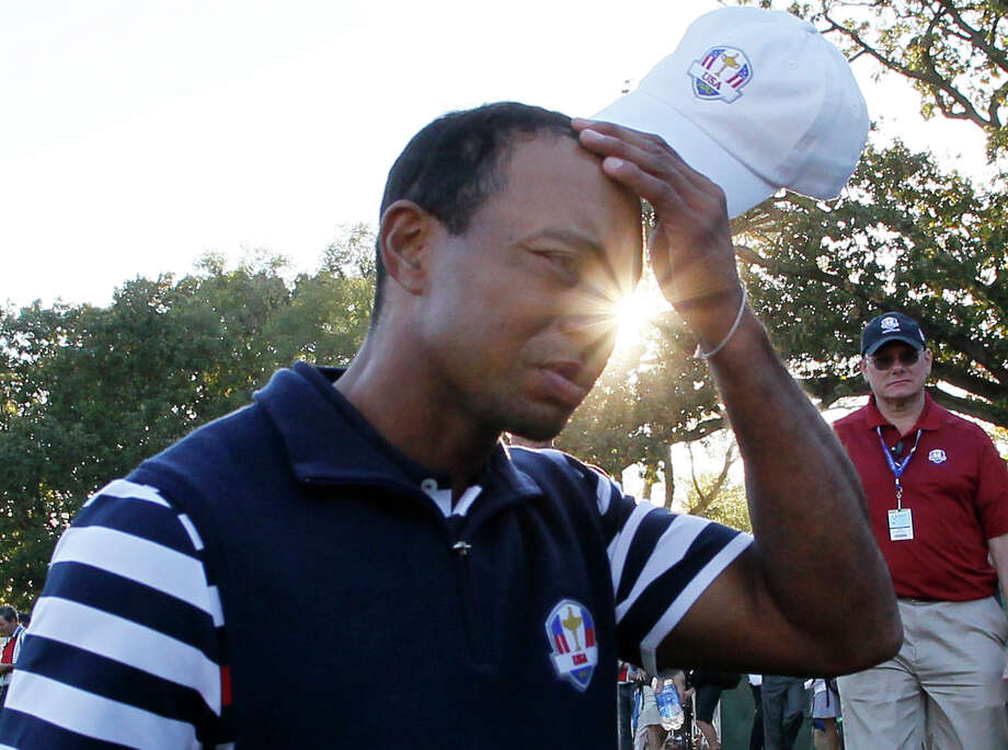 USA's Tiger Woods scratches his head as he walks off the course after the Ryder Cup PGA golf tournament Sunday, Sept. 30, 2012, at the Medinah Country Club in Medinah, Ill. (AP Photo/Charles Rex Arbogast) Photo: Charles Rex Arbogast, Associated Press / AP