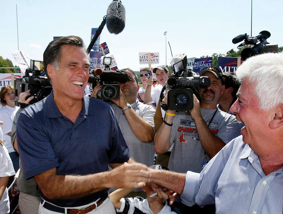 FILE - In this Sept. 3, 2007, file photo Republican presidential hopeful, former Massachusetts governor Mitt Romney, left, shakes hands with Democratic presidential hopeful, U.S. Sen. Chris Dodd, D-Conn., at the Labor Day parade in Milford, N.H. Romney also crossed paths at the parade with another rising political star and presidential contender, Barack Obama, as both sought to line up votes in the New Hampshire primary. They shook hands, exchanged a few pleasantries and turned their attention to the voters. When they stand side by side on the presidential debate stage Wednesday night, Oct. 3, 2012, it will be one of the few times they have ever even met in person. (AP Photo/Jim Cole, File) Photo: Jim Cole / AP