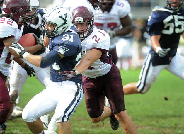 Milford Academy fullback Mike Rivas, of Stamford, opens up a hole with a block during his team's victory over Yale University's practice squad in New Haven on Sunday, September 30, 2012. Photo: Brian A. Pounds / Connecticut Post
