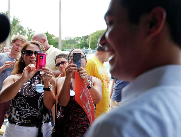 People photograph Mayor Julián Castro during a rally Sunday Sept. 30, 2012 at Lechonera El Barrio Restaurant in Orlando, FL.  Castro helped energize volunteers for the Obama For America campaign. Scores of volunteers fanned out through Orlando neighborhoods to talk to potential voters about re-electing the president and register new voters. Castro thanked the volunteers, who headed back out to continue their work leading up to Oct. 9, the last day to register voters. Photo: Edward A. Ornelas, Express-News / © 2012 San Antonio Express-News