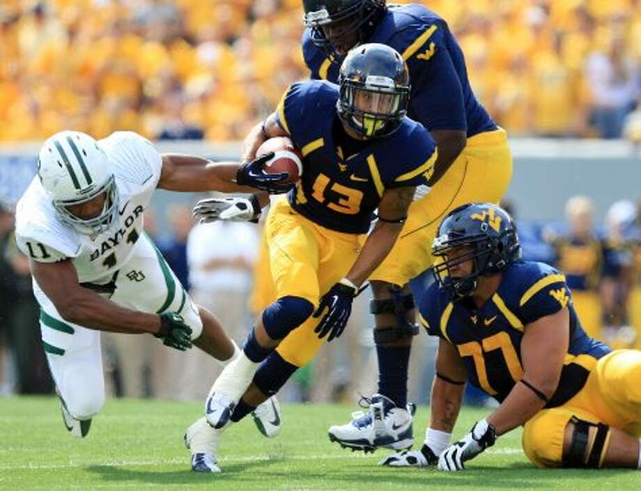 Andrew Buie, West Virginia, 25 carries, 82 yards, 2 TDs (Christopher Jackson / Associated Press)