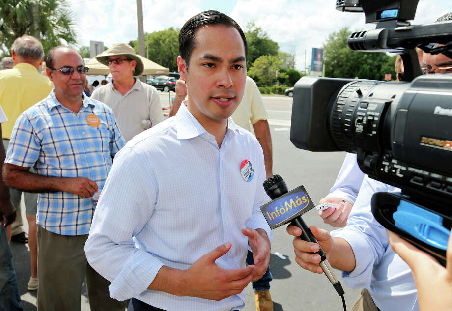 Mayor Julián Castro answers questions from the media after a rally Sunday Sept. 30, 2012 at Lechonera El Barrio Restaurant in Orlando, FL.  Castro helped energize volunteers for the Obama For America campaign. Scores of volunteers fanned out through Orlando neighborhoods to talk to potential voters about re-electing the president and register new voters. Castro thanked the volunteers, who headed back out to continue their work leading up to Oct. 9, the last day to register voters. Photo: Edward A. Ornelas, Express-News / © 2012 San Antonio Express-News
