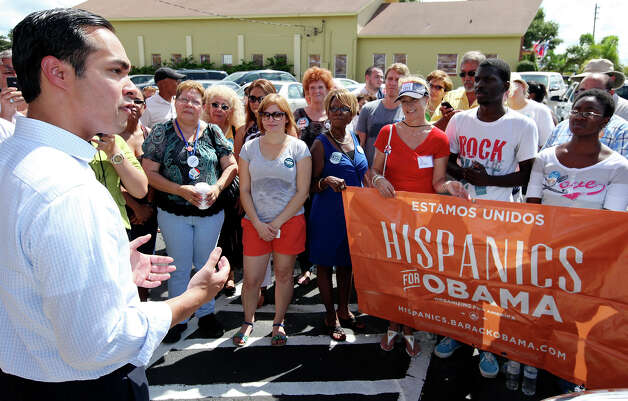 Mayor Julián Castro (left) speaks during a rally Sunday Sept. 30, 2012 at Lechonera El Barrio Restaurant in Orlando, FL.  Castro helped energize volunteers for the Obama For America campaign. Scores of volunteers fanned out through Orlando neighborhoods to talk to potential voters about re-electing the president and register new voters. Castro thanked the volunteers, who headed back out to continue their work leading up to Oct. 9, the last day to register voters. Photo: Edward A. Ornelas, Express-News / © 2012 San Antonio Express-News