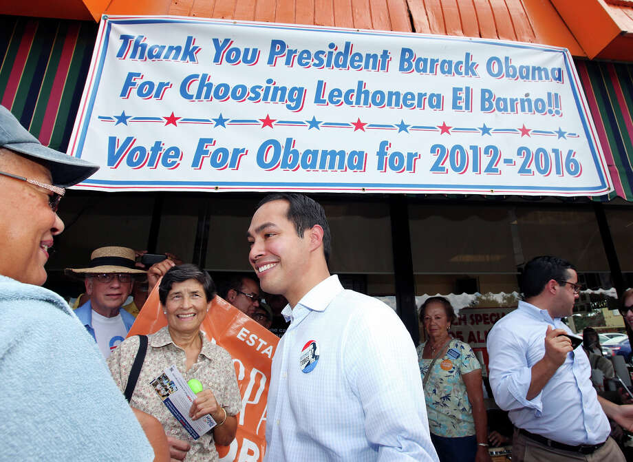 Mayor Julián Castro (center) talks with people during a rally Sunday Sept. 30, 2012 at Lechonera El Barrio Restaurant in Orlando, FL.  Castro helped energize volunteers for the Obama For America campaign. Scores of volunteers fanned out through Orlando neighborhoods to talk to potential voters about re-electing the president and register new voters. Castro thanked the volunteers, who headed back out to continue their work leading up to Oct. 9, the last day to register voters. Photo: Edward A. Ornelas, Express-News / © 2012 San Antonio Express-News