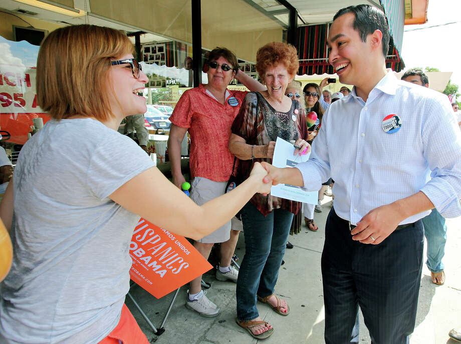 Obama for America national co-chair Lynette Acosta (left) greets Mayor Julián Castro during a rally Sunday Sept. 30, 2012 at Lechonera El Barrio Restaurant in Orlando, FL.  Castro helped energize volunteers for the Obama For America campaign. Scores of volunteers fanned out through Orlando neighborhoods to talk to potential voters about re-electing the president and register new voters. Castro thanked the volunteers, who headed back out to continue their work leading up to Oct. 9, the last day to register voters. Photo: Edward A. Ornelas, Express-News / © 2012 San Antonio Express-News