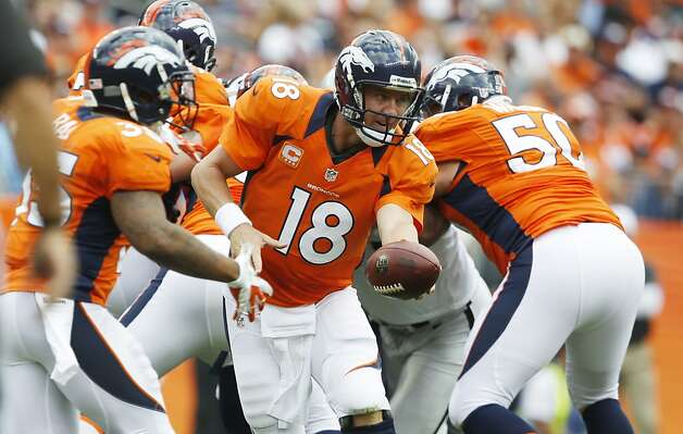 Denver Broncos quarterback Peyton Manning turns to hand off the ball against the Oakland Raiders during the first quarter of an NFL football game, Sunday, Sept. 30, 2012, in Denver. (AP Photo/David Zalubowski) Photo: David Zalubowski, Associated Press