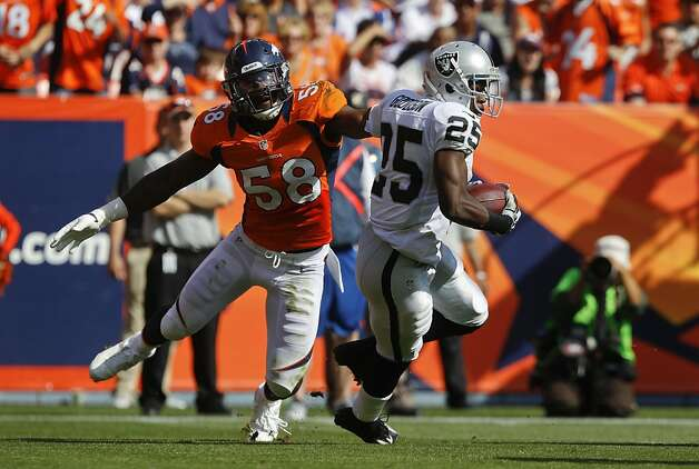 Denver Broncos outside linebacker Von Miller (58) reaches for Oakland Raiders running back Mike Goodson (25) during the second quarter of an NFL football game, Sunday, Sept. 30, 2012, in Denver. (AP Photo/David Zalubowski) Photo: David Zalubowski, Associated Press