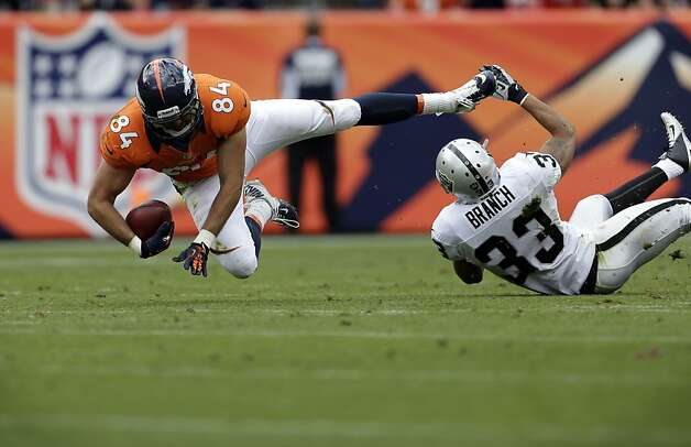 Denver Broncos Jacob Tamme (84) is against Oakland Raiders Tyvon Branch (33) during the second quarter of an NFL football game, Sunday, Sept. 30, 2012, in Denver. (AP Photo/Joe Mahoney) Photo: Joe Mahoney, Associated Press