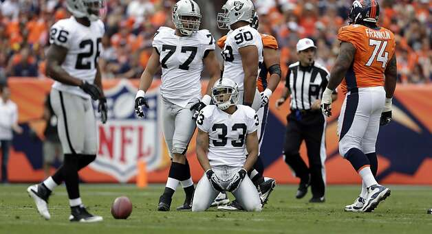 Oakland Raiders Tyvon Branch (33)  kneels after a play during the second quarter of an NFL football game, Sunday, Sept. 30, 2012, in Denver. (AP Photo/Joe Mahoney) Photo: Joe Mahoney, Associated Press