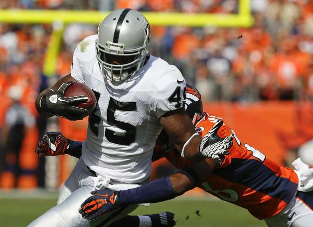 Oakland Raiders fullback Marcel Reece (45) is hit by Denver Broncos free safety Rahim Moore (26) during the second quarter of an NFL football game, Sunday, Sept. 30, 2012, in Denver. (AP Photo/David Zalubowski) Photo: David Zalubowski, Associated Press