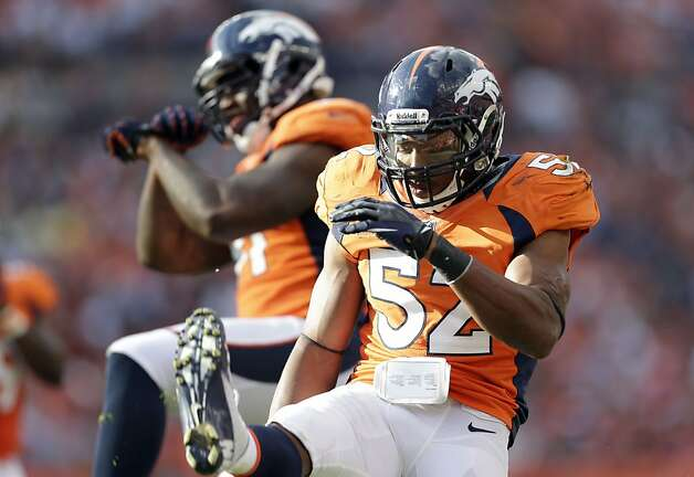 Denver Broncos Wesley Woodyard (52) and Robert Ayers (91) during the third quarter of an NFL football game, Sunday, Sept. 30, 2012, in Denver. (AP Photo/Joe Mahoney) Photo: Joe Mahoney, Associated Press