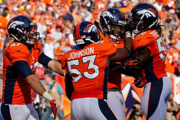DENVER, CO - SEPTEMBER 30:  Safety David Bruton #30 of the Denver Broncos is mobbed by teammates Mike Mohamed #47, Linebacker Steven Johnson #53 and Linebacker Danny Trevathan #59 after blocking a punt against the Oakland Raiders at Sports Authority Field Field at Mile High on September 30, 2012 in Denver, Colorado. The blocked punt led to a touchdown as the Broncos defeated the Raiders 37-6.  (Photo by Justin Edmonds/Getty Images) Photo: Justin Edmonds, Getty Images